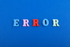 ERROR word on blue background composed from colorful abc alphabet block wooden letters, copy space for ad text. Learning. English concept stock photography