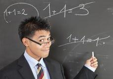 Errore indicante dell'insegnante per la matematica Fotografie Stock Libere da Diritti