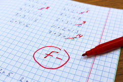 Errors corrected in red pen in a notebook. Royalty Free Stock Photography