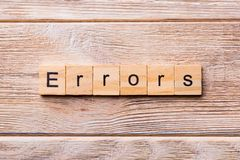 Errors word written on wood block. Errors text on wooden table for your desing, concept.  stock photography