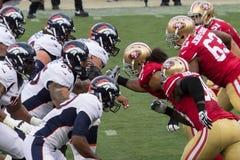 49ers versus Wild paarden Stock Foto's