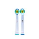 Ersatzköpfe der elektrischen Zahnbürste mit Farbringen Lizenzfreie Stockfotos