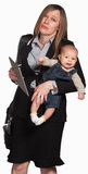 Erschöpfte berufstätige Mutter mit Schätzchen Stockfotografie
