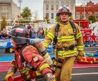Erschöpfter Feuerwehrmann an Weltkampf-Herausforderung XXIV Lizenzfreie Stockfotos