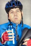 Erschöpfter Radfahrer Stockbild