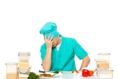 Erschrockene gesorgte Haltung des Kochs Mann Lokalisiertes Weiß Stockbilder
