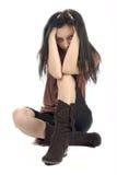 Erschrockene junge Frau Stockfoto