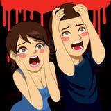 Erschrockene schreiende Paare Stockfotografie