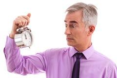 Erschrockener Geschäftsmann mit Uhr Lizenzfreie Stockfotografie