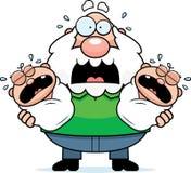 Erschrockener Karikatur-Großvater mit Zwillingen Stockbilder
