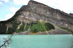 Erstaunliche Farben von Lake Louise und von felsigen Bergen Lizenzfreie Stockfotos