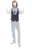 Erstaunter Pantomimeschauspieler, der oben Daumen anhebt stockfotos