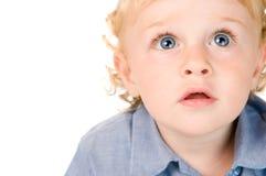 Erstauntes und überraschtes kleines Kind Lizenzfreie Stockfotos
