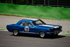 1965 Erste-Generationshard-top Ford Mustang in Monza Stockfoto