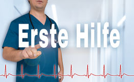 Erste Hilfe in germn First Aid doctor shows on viewer with hea Stock Photo
