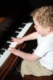 Erste Klavierlektion Lizenzfreie Stockbilder
