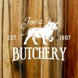 Erstklassiger Weinleserindfleischstieraufkleber auf unscharfem Holz Lizenzfreies Stockfoto