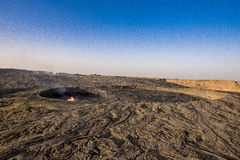 Erta Ale's caldera. Panoramic view of the caldera at the top of the Erta Ale volcano and its active lava lake Stock Photo