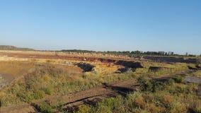 Ertssteengroeve kuil Stock Foto's