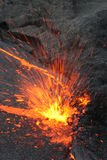 Eruptin in the lava lake. Degassing at the edge of the lava lake in the ethiopian Erta Ale volcano Royalty Free Stock Photo