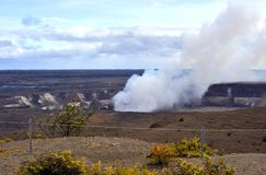 Erupting crater, Hawaii Volcanoes Park. Panoramic view of Kalauea Caldera, one of the world's most active volcanoes Royalty Free Stock Images