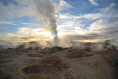 Erupting hot geyser of steam. Erupting geyser of steam with sulfur deposits, Bolivia Stock Photos