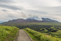 Erupting Mount Aso volcano view from natural trail in Kumamoto, Kyushu, Japan royalty free stock photos
