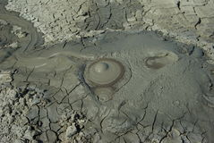 Erupting mud vulcano background Stock Photo