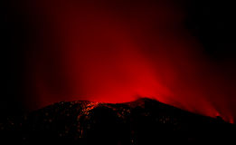Eruption of active volcano. Right after sunset Stock Photo