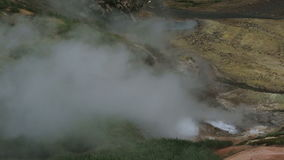 Eruption of the geyser Bolshoy in Valley of Geysers stock footage video. Kamchatka Peninsula in the summer stock video