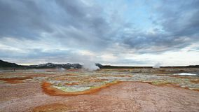 Eruption of geyser in Iceland. Red soil, like the surface of the planet Mars.  stock video