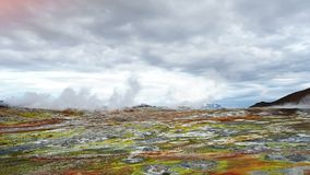 Eruption of geyser in Iceland. Red soil, like the surface of the planet Mars.  stock footage