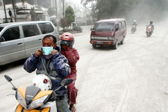 Eruption of Mount Kelud. The road users using a mask which shared the volunteers in the event of rain ash volcanic from an eruption of Mount Kelud that closed stock photos
