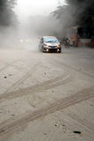 Eruption of Mount Kelud. Some of vehicles on a street covered with volcanic ash from an eruption of Mount Kelud, in Solo, Indonesia, Friday, Feb. 14, 2014. A stock photos