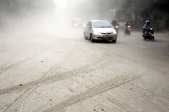 Eruption of Mount Kelud. Some of vehicles on a street covered with volcanic ash from an eruption of Mount Kelud, in Solo, Indonesia, Friday, Feb. 14, 2014. A stock photo