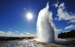 Eruption of Strokkur Geyser with sun burst Royalty Free Stock Image