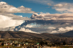 Eruption of the Tungurahua volcano. Column of ash from the eruption of the Tungurahua volcano confused with clouds Royalty Free Stock Photo
