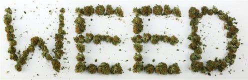 Erva daninha soletrada com marijuana Fotos de Stock