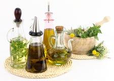 Ervas e óleo Fotografia de Stock