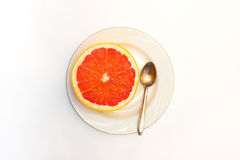 Erved fresh grapefruit composition isolated over the white background, top view. Erved  grapefruit composition isolated over the white background, top view Royalty Free Stock Photo
