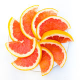 Erved fresh grapefruit composition isolated over the white background, top view. Erved  grapefruit composition isolated over the white background, top view Royalty Free Stock Images