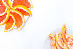 Erved fresh grapefruit composition isolated over the white background, top view. Erved  grapefruit composition isolated over the white background, top view Stock Photos