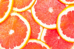 Erved fresh grapefruit composition isolated over the white background, top view. Erved  grapefruit composition isolated over the white background, top view Royalty Free Stock Image