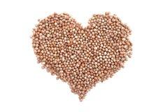 Ervilhas de pombo secadas em uma forma do coração fotos de stock