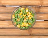 Ervilhas e milho orgânicos congelados Fotografia de Stock Royalty Free