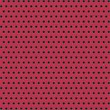 Ervilhas pretas em um fundo vermelho Fotografia de Stock Royalty Free