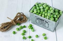 Ervilhas verdes congeladas Fotografia de Stock Royalty Free