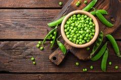 Ervilhas verdes frescas Fotos de Stock