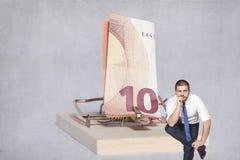 Erwägender Geschäftsmann, ein Risiko einzugehen Stockfoto