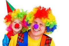Erwachsene und kleine Clowne Stockfotografie